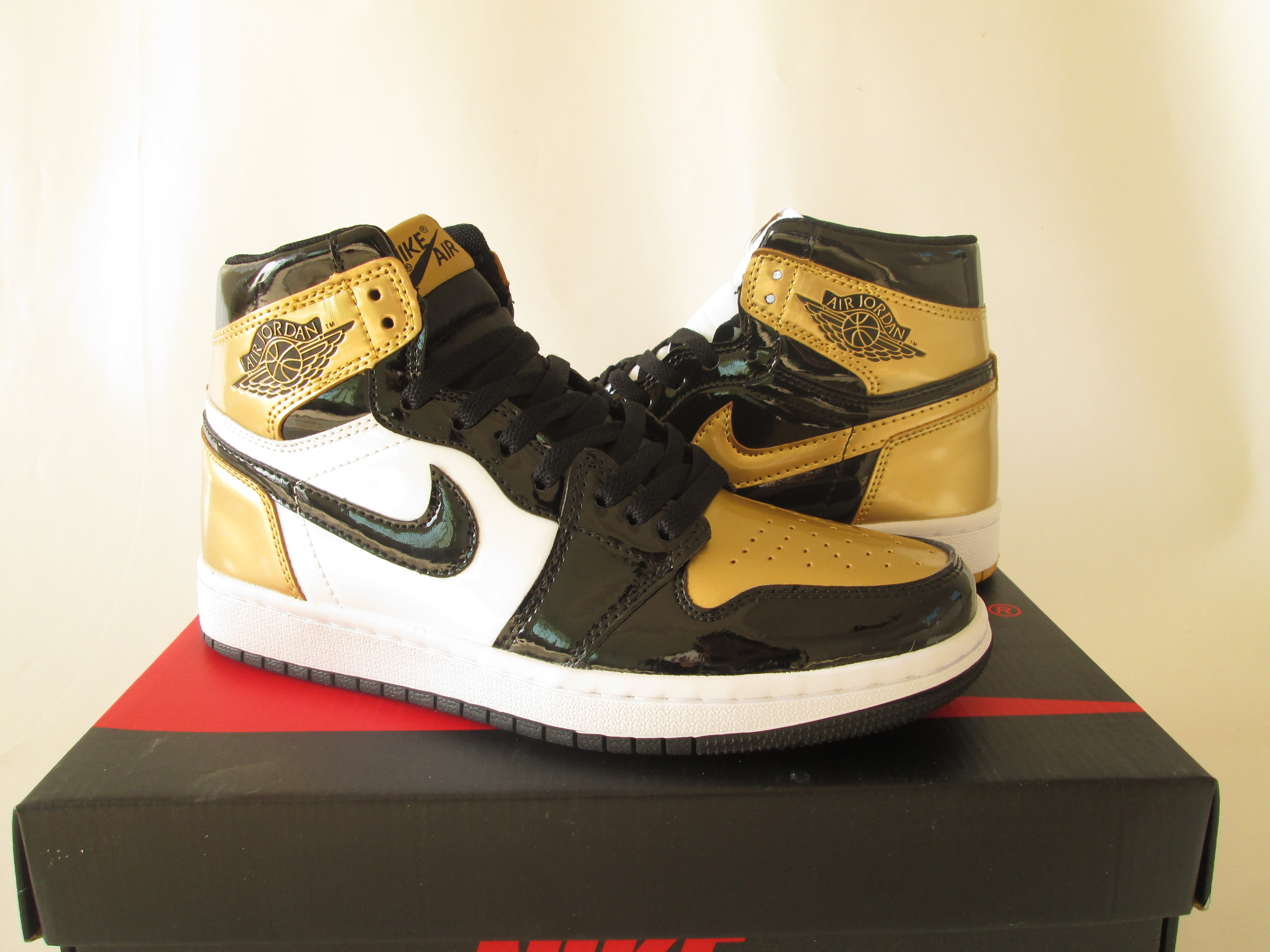 What The Jordan of Air Jordan 1 Black Gold White Shoes